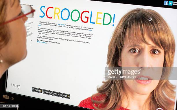 A woman looks at a computer site on November 30 2012 in Washington DC Just in time for the holidays Microsoft and Google have become embroiled in a...