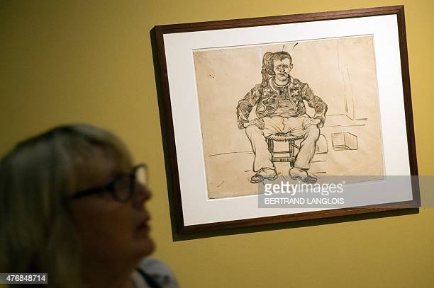 A woman looks at a draw entitled 'Seated Zouave Arles 1888' by Dutch artist Vincent Van Gogh during the 'Van Gogh Drawings Influence and Innovations'...