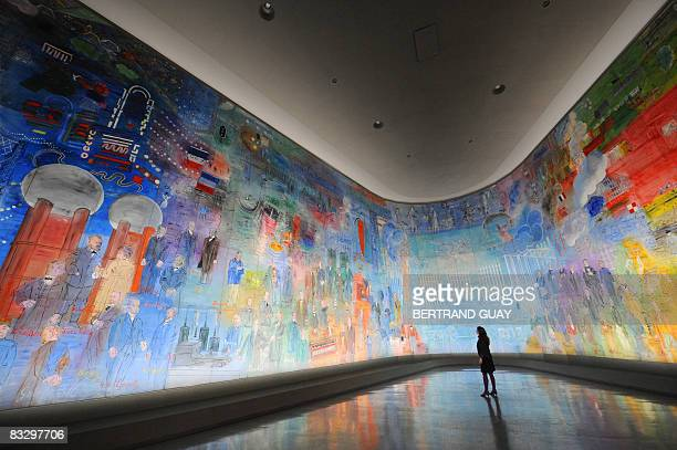 A woman looks at a fresco by French Fauvist painter Raoul Dufy entitled La Fée électricité on October 16 2008 during the exhibition Raoul Dufy le...
