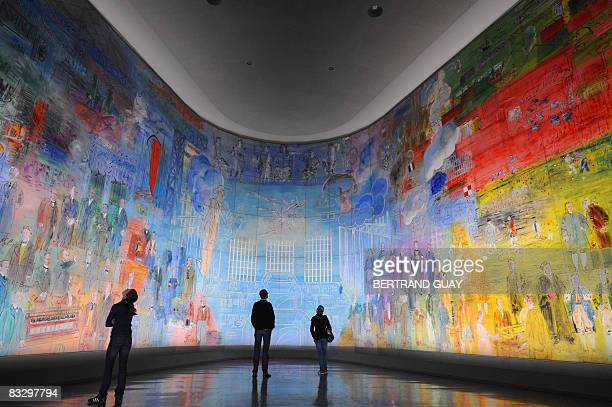 """Woman looks at a fresco by French Fauvist painter Raoul Dufy entitled """"La Fée électricité"""" , on October 16, 2008 during the exhibition """"Raoul Dufy,..."""