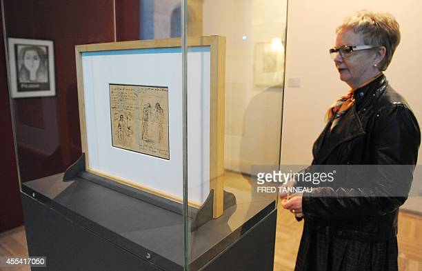 A woman looks at a letter from 1903 by Spanish artist Pablo Picasso adressed to French poet Max Jacob on September 14 2014 at the Musee des BeauxArts...