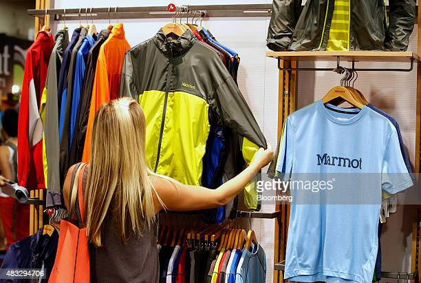 A woman looks at a Marmot Mountain LLC jacket during the 2015 Outdoor Retailer Summer Market show at the Salt Palace Convention Center in Salt Lake...