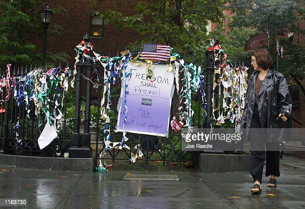 A woman looks at a memorial for the victims of the World Trade Center disaster September 14 2001 in Union Square Park in New York City The World...
