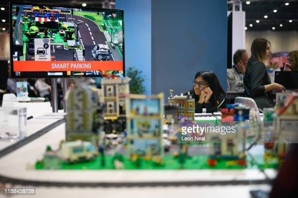 A woman looks at a model of an autonomous Smart City on the Oracle display stand during the TechXLR8 event at ExCel on June 12 2019 in London England...