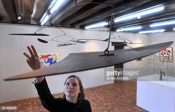 A woman looks at a moving sculpture of US scupltor and painter Alexander Calder on June 4 2008 in Tours western France 90 of Calder's masterpieces...