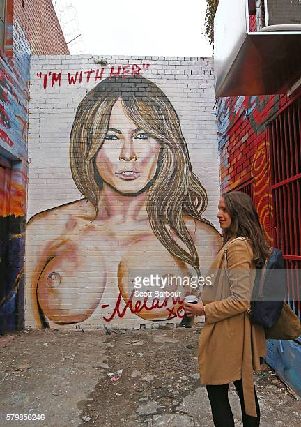 A woman looks at a mural by Melbourne graffiti artist Lushsux of Melania Trump the wife of 2016 US presidential candidate Donald Trump in an alleyway...
