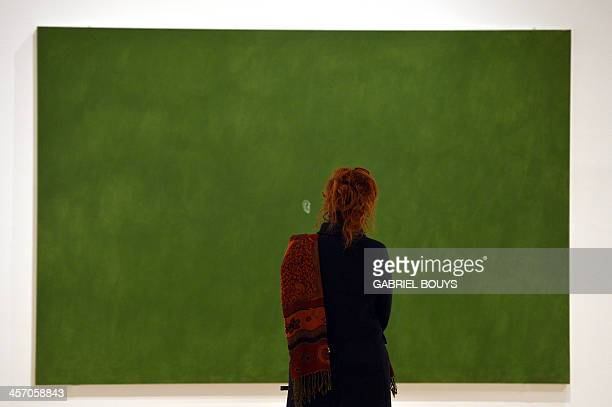 A woman looks at a painting by Cesare Tacchi Sentire as part of the exhibition Anni 70 Arte a Roma during a press preview at the Palazzo delle...
