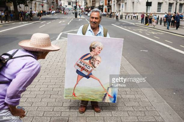 A woman looks at a painting by political artist Kaya Mar on Whitehall ahead of the proEU 'March for a People's Vote' in London England on June 23...