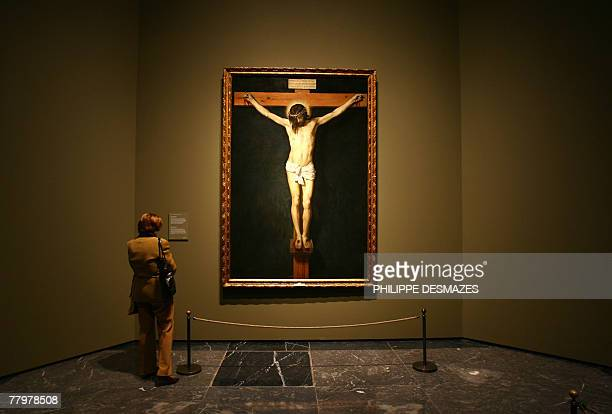 A woman looks at a painting by Spanish artist Diego Velazquez at the opening of a new exhibition on the mythological paintings of Velazquez at the...