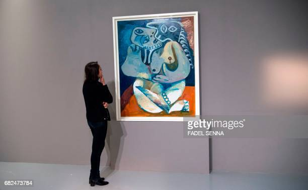 A woman looks at a painting by Spanish artist Pablo Picasso ahead of an exhibition held in the Museum of Modern and Contemporary Art in the Moroccan...