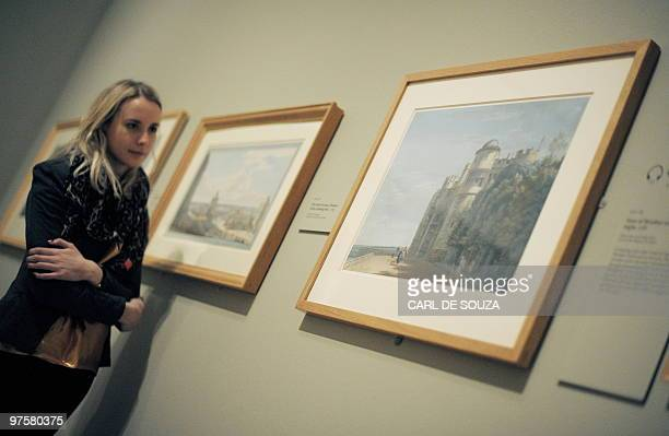 A woman looks at a painting of the North terrace of Windsor Castle by British artist Paul Sandby during a photocall for 'Paul Sandby RA Picturing...