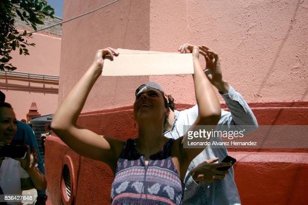 A woman looks at a partial solar eclipse in the Institute of Astronomy and Meteorology at Guadalajara University on August 21 2017 in Guadalajara...