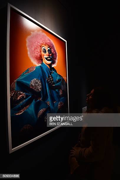 Woman looks at a photograph by Cindy Sherman entitled 'What Lies Beneath' 2003 as part of the 'Vogue 100 a Century of Style' exhibition at the...