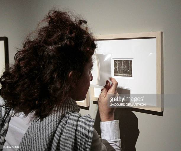 A woman looks at a picture by HungarianBorn US photographer Andre Kertesz on September 27 2010 at the 'Jeu de Paume' in Paris on the eve of the start...