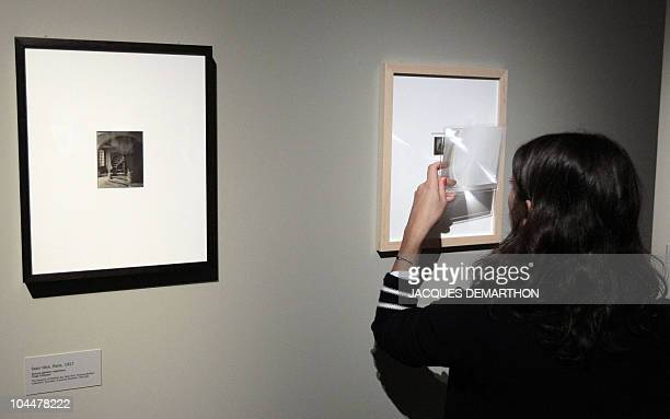 A woman looks at a picture by HungarianBorn US photographer Andre Kertesz on September 27 2010 at the Jeu de Paume in Paris on the eve of the start...