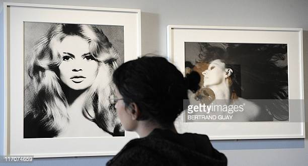 A woman looks at a picture of French actress Brigitte Bardot as she visits the exhibition Brune/Blonde at the French cinematheque on October 13 in...