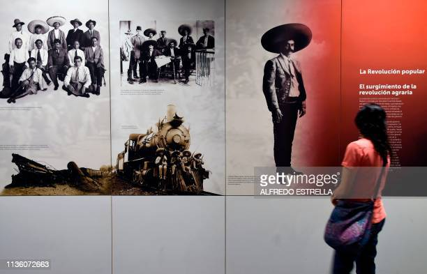 A woman looks at a picture of Mexican revolutionary leader Emiliano Zapata displayed at the National Museum of the Revolution in Mexico City on April...