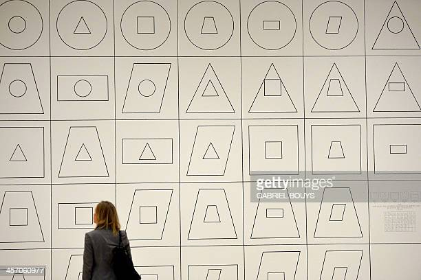 A woman looks at a piece of art by Sol LeWitt Wall drawing as part of the exhibition Anni 70 Arte a Roma during a press preview at the Palazzo delle...