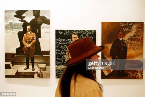A woman looks at a piece of work titled 'The Greek way' which is an installation that juxtaposes the work of Piotr Uklanski and McGouth at a preview...