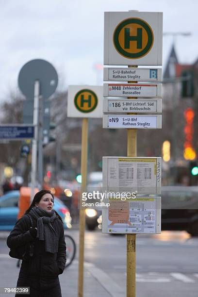 A woman looks at a public bus schedule during a strike of Berlin's BVG public transportation services February 1 2008 in Berlin Germany BVG workers...