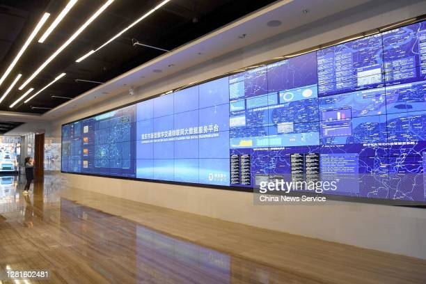 Woman looks at a screen displaying real-time traffic information based on the Chongqing New Type Internet of Things Big Data Service Platform for...