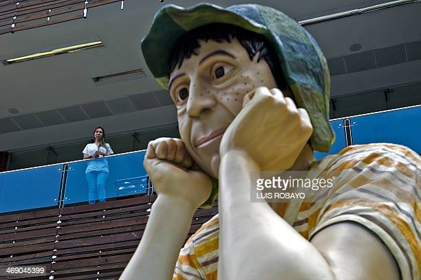 A woman looks at a sculpture of the famous Latin American TV character El Chavo del Ocho starred by Mexican artist Roberto Gomez Bolaños aka...