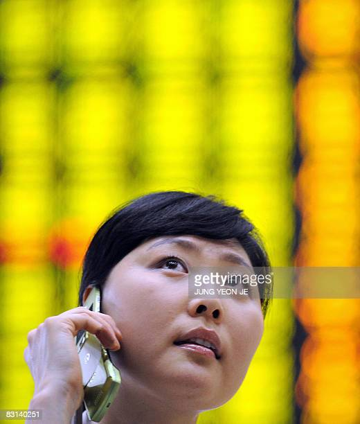 A woman looks at a stock index board at the Korea Exchange in Seoul on October 6 2008 South Korean shares closed 43 percent lower October 6 on fears...