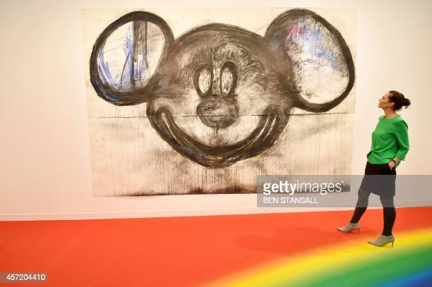 A woman looks at a work of art by US artist Joyce Pensato entitled Micky for Micky 2014 displayed at the Frieze Art Fair in London on October 14 2014...