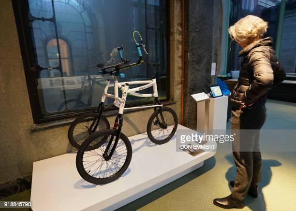 A woman looks at an Afari an outdoor mobility aid for jogging running and walking on diverse terrain which is displayed as part of the AccessAbility...