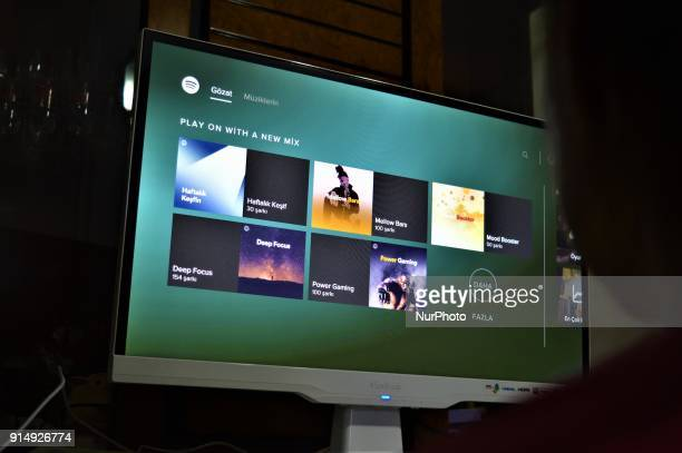 A woman looks at an application of digital music and video streaming service Spotify in Ankara Turkey on February 5 2018 as an omnibus bill...