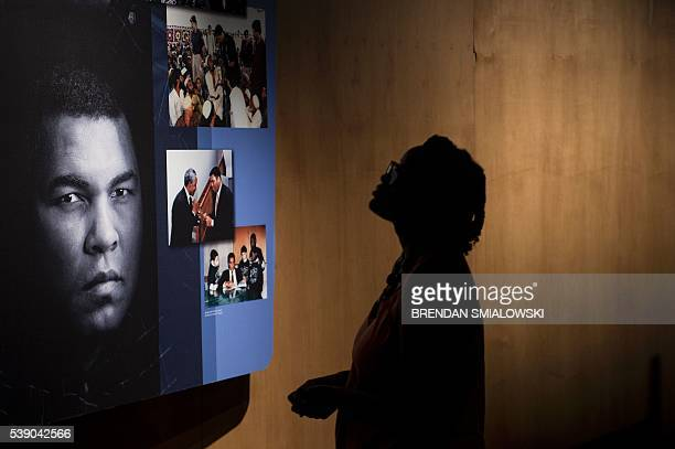 A woman looks at an exhibit in the Muhammad Ali Center June 9 2016 in Louisville Kentucky Two days of funeral ceremonies bidding farewell to Muhammad...