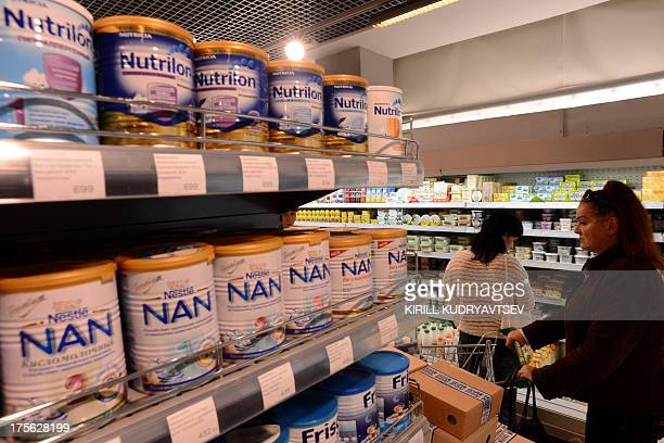 A woman looks at baby formula among dairy products in a supermarket in central Moscow on August 5 2013 AFP PHOTO/KIRILL KUDRYAVTSEV