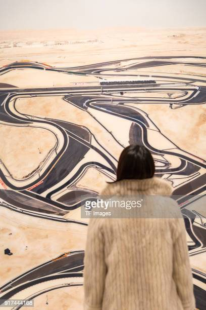 A woman looks at 'Bahrain I' by Andreas Gursky in the reopened Hayward Gallery on January 24 2018 in London England
