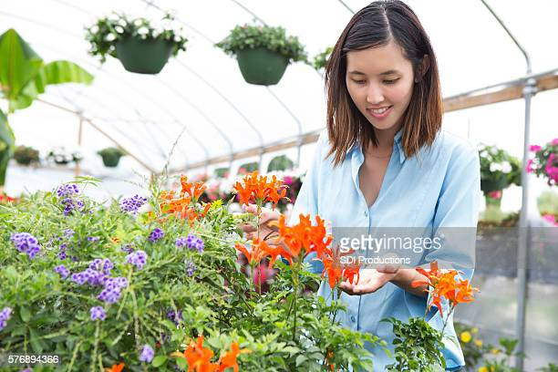 Woman looks at beautiful flowers