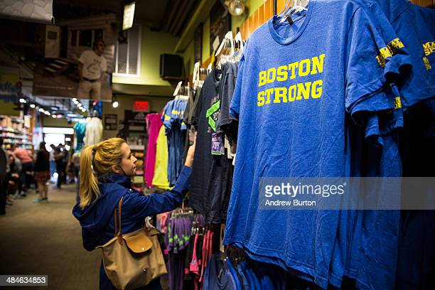 A woman looks at 'Boston Strong' shirts for sale inside Marathon Sports a running apparal store that sits in front of the site of one of the bombings...