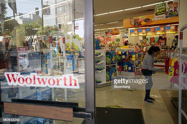 A woman looks at children's clothing at a Woolworth store in Mexico City Mexico on Thursday July 16 2015 Blockbuster Woolworth and Sears extinct or...