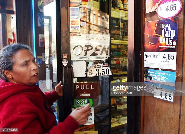 A woman looks at cigarettes prices outside of a store February 19 2002 in New York City As part of his recent budget plan New York Mayor Michael...