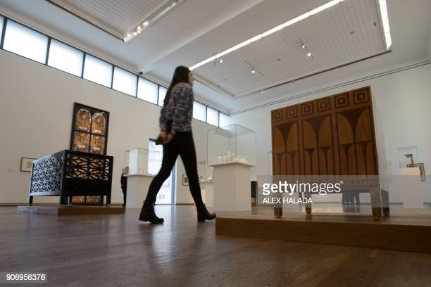 A woman looks at creations by Austrian artist Koloman Moser during the exhibition titled 'Vienna 1900' devoted to the key figures of the Viennese...