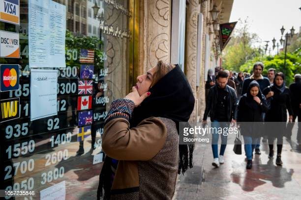 A woman looks at currency exchange rate information in the window of a store in Tehran Iran on Saturday Nov 3 2018 Irans Supreme Leader Ayatollah...