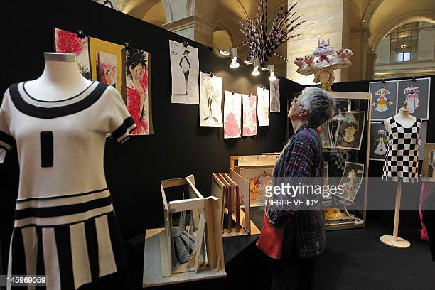 A woman looks at drawings from the Folies Bergere displayed at the Palais de la Bourse as part of the Ventes de folie auction in Paris on June 8 2012...