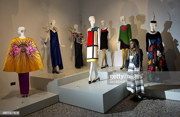 A woman looks at dresses designed by Yves Saint Laurent including one in homage to Dutch painter Piet Mondrian during a photocall at the Bowes Museum...