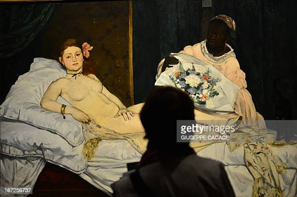 A woman looks at Edouard Manet's 'Olympia' on April 23 2013 in Venice during the 'Manet Return to Venice' exhibition which runs until 18 August 2013...