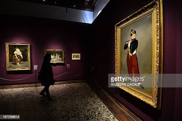 A woman looks at Edouard Manet's painting named Le fifre on April 232013 in Venice during the 'Manet Return to Venice' exhibition which runs until 18...