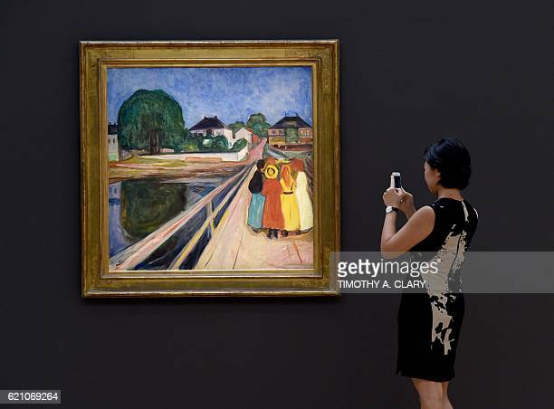 A woman looks at Edvard Munch's 'Pikene på broen ' on display during the media preview on November 4 2016 for Sothebys New York evening auctions of...