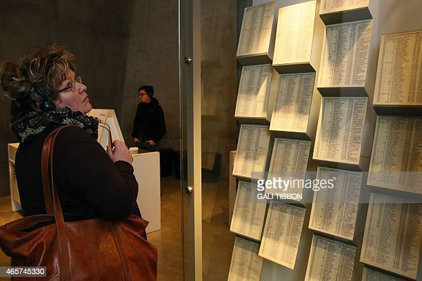 Woman looks at facsimiles of Oskar Schindler's lists displayed for the public at the Yad Vashem Holocaust memorial museum in Jerusalem, where the...