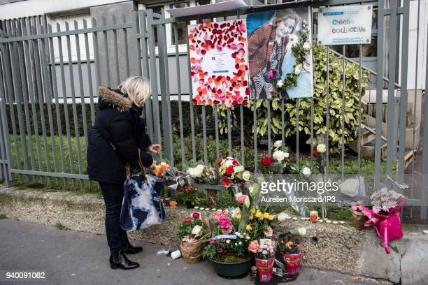 A woman looks at flower tributes on the sidelines of the Silent March In Memory Of Mireille Knoll who survived the Holocaust but was recently...