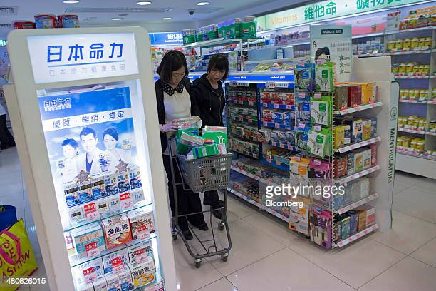A woman looks at Fonterra Cooperative Group Ltd Anlene branded milk products in her shopping cart in a Watsons store operated by AS Watson Co in the...