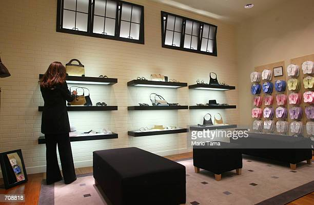 A woman looks at handbags for sale in the new Ann Taylor Loft store located near Ground Zero April 22 2002 in New York City Ann Taylor is the first...