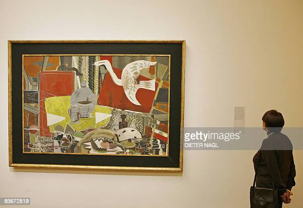 A woman looks at information on the painting 'Atelier VIII' by French artist Georges Braque at the Bank Austria Kunstforum on November 13 2008 in...