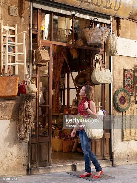 woman looks at items outside shop - palma de mallorca bildbanksfoton och bilder